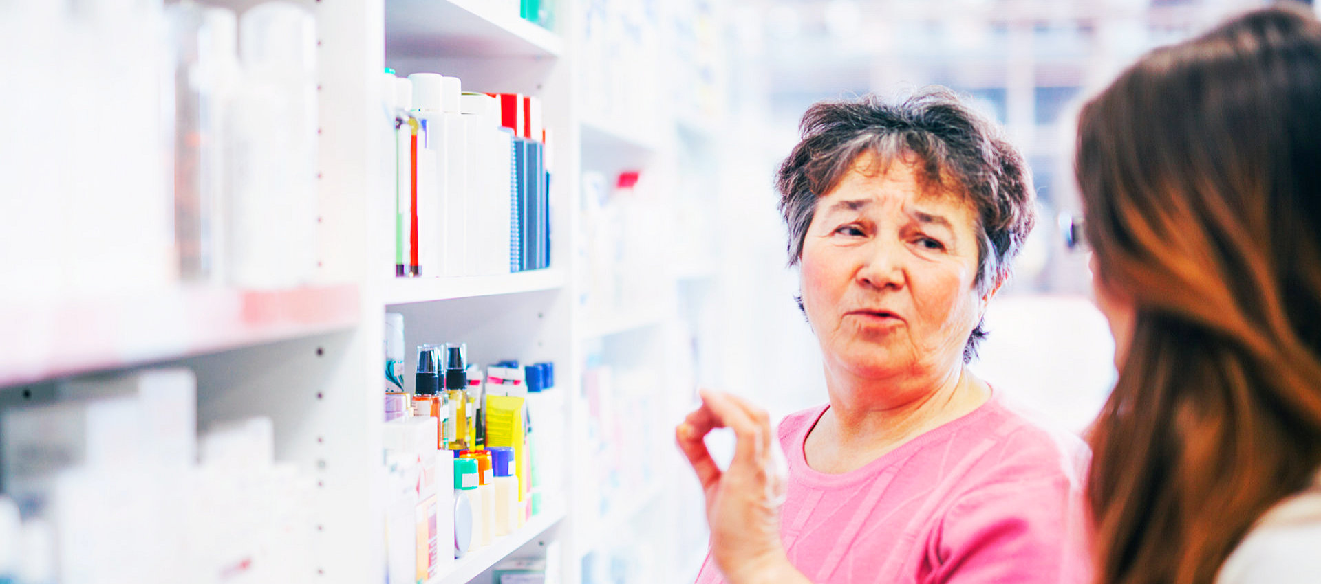 old woman client talking to the pharmacist