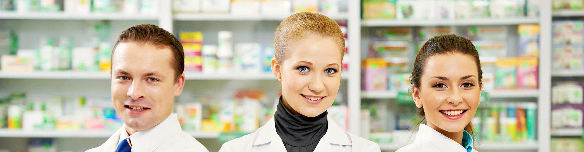 smiling pharmacist at the pharmacy store