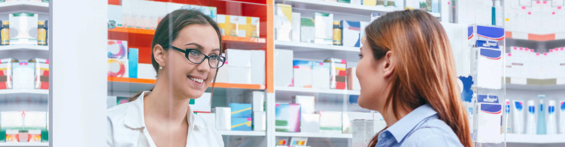 smiling pharmacist while talking to her client