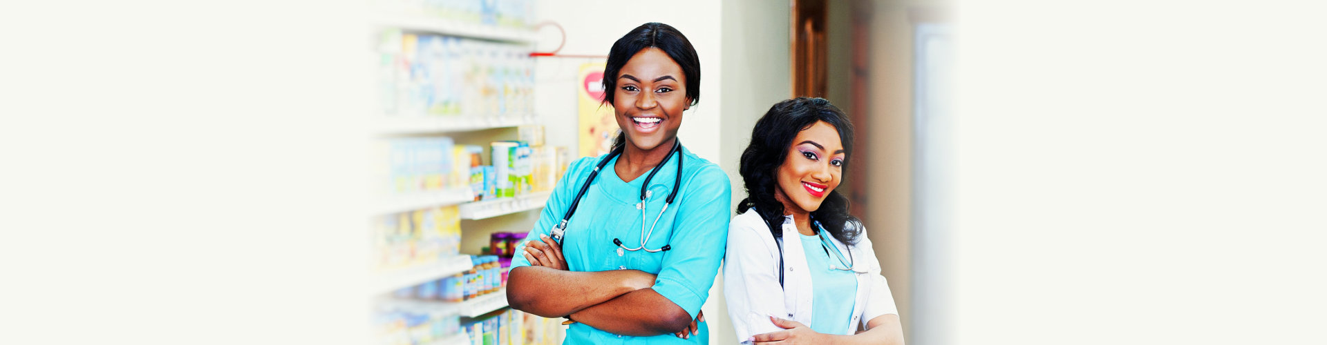 Two african american pharmacist working in drugstore at hospital pharmacy